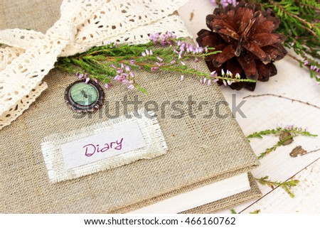 Private diary with handmade cover decorated with crochet ribbon and natural evergreen  flower of wild erica / heather. Dreaming concept    #466160762