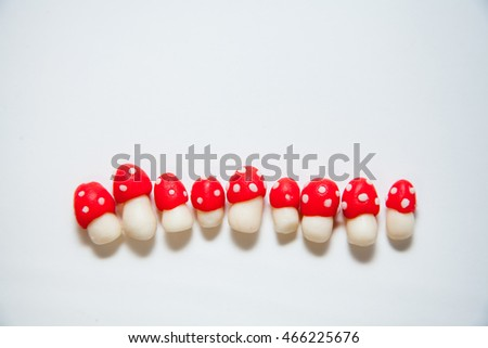 Chocolate cake decorated with meringue mushrooms and physalis isolated on white background #466225676