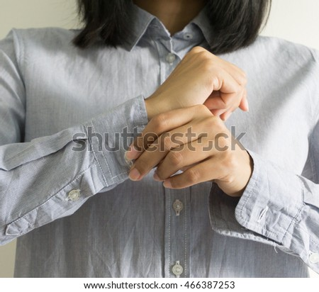 Woman dressing up and fastening buttons on shirt at home. #466387253