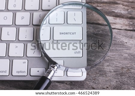 Business concept: SHORTCUT on computer keyboard on wooden background with copyspace area. Royalty-Free Stock Photo #466524389