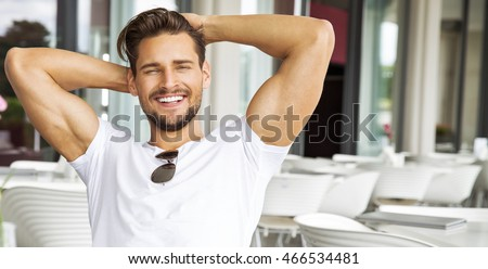 Portrait of handsome smiling man  Royalty-Free Stock Photo #466534481