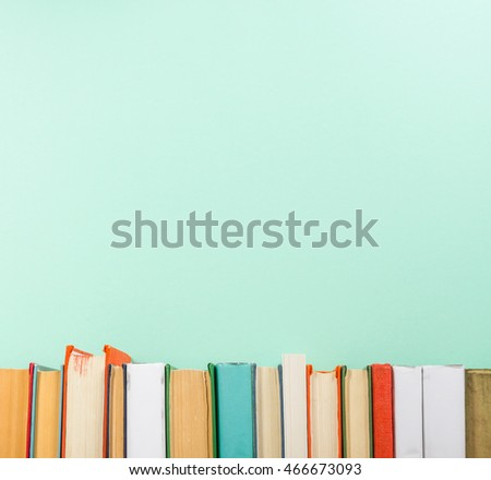 Books on grunge wooden table desk shelf in library. Back to school background with copy space for your ad text. Old hardback   no labels, blank spine #466673093
