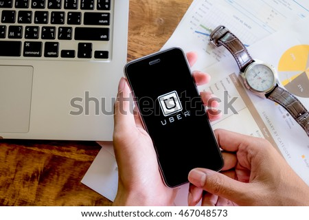 CHIANG MAI,THAILAND - AUG 2,2016 : A woman hand holding Uber app showing on Samsung note 3,Uber is smartphone app-based transportation network. #467048573