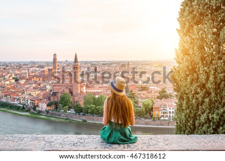 Woman enjoying beautiful view on Verona city in Italy on the sunset. Verona is famous city of love in the north of Italy. #467318612