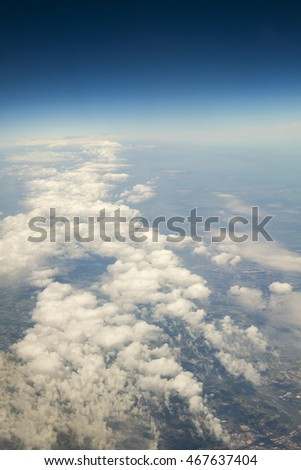 Aerial view above clouds and landscape #467637404