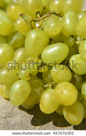 Ripe white grapes on green background #467676302