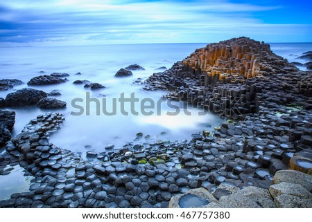 The nature hexagon stones at the beach called Giant's Causeway, the landmark in  Northern Ireland. Royalty-Free Stock Photo #467757380