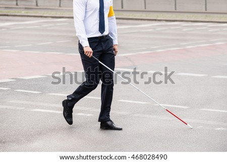 Blind Person With White Stick Walking On Street #468028490