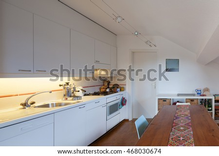 Kitchen of a loft, old wooden dining table #468030674