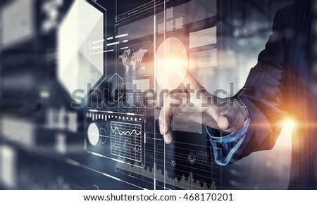 Businessman using innovative technologies . Mixed media #468170201