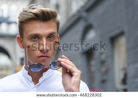 Attractive guy expressing his confidence #468228302