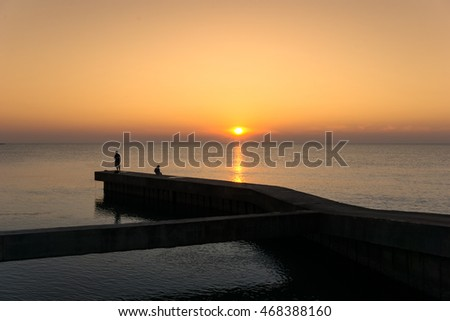 jetty in the morning with silhouette of tourist #468388160