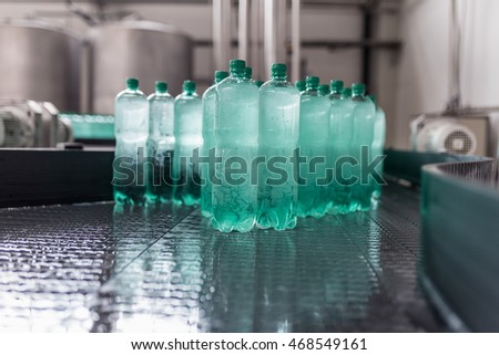 Water bottling line for processing and bottling pure mineral carbonated water into bottles. Selective focus. #468549161