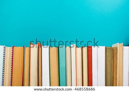 Books on grunge wooden table desk shelf in library. Back to school background with copy space for your ad text. Old hardback   no labels, blank spine #468558686