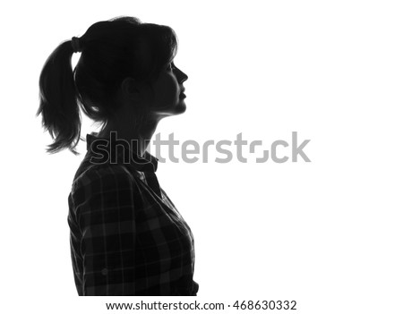 silhouette girl face looking up on white isolated background, woman profile #468630332