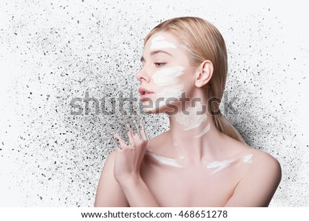 WOMEN'S PORTRAIT disintegrate into particles. WHITE WOMEN FACE SCRUB, CLAY FACE. Beauty Portrait. Perfect Fresh Skin. Youth and Skin Care Concept. Isolated on WHITE background.     #468651278