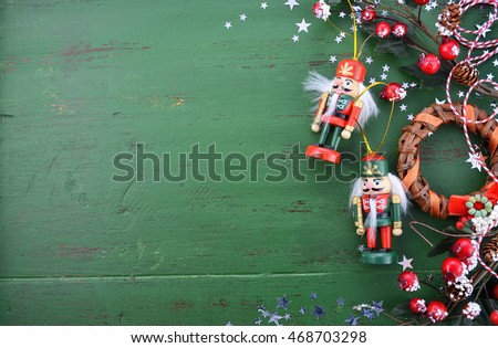 Happy Holidays Christmas background with copy space and borders decorated with ornaments on a rustic green wood background.  #468703298