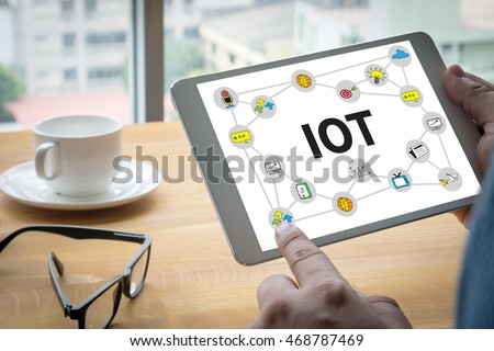 IOT business man hand working and internet of things (IoT) word diagram as concept #468787469