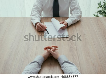 Examiner reading a resume during a job interview, employment and recruitment concept, point of view shot Royalty-Free Stock Photo #468856877
