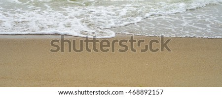 Waves on a sandy beach. Black Sea coast of the Crimean Peninsula. Background for web pages and printing. #468892157
