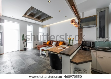 View from kitchen to living room in modern flat interior #468970550