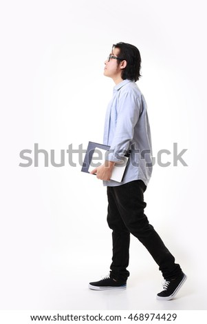 The Asian man standing on the white background. #468974429