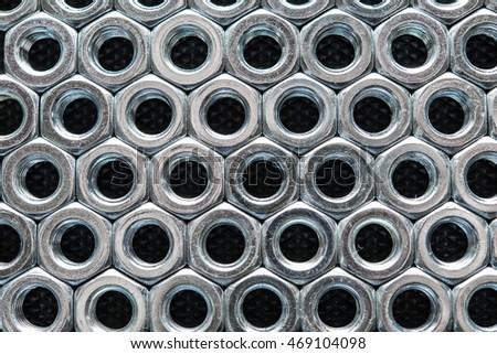 Metal nuts background #469104098