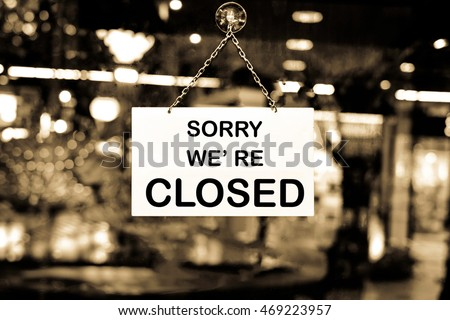 Close up of closed sign on shop door #469223957