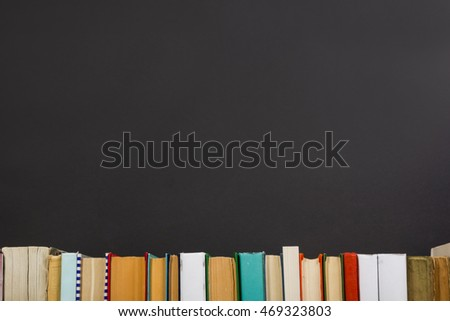 Books on grunge wooden table desk shelf in library. Back to school background with copy space for your ad text. Old hardback   no labels, blank spine #469323803