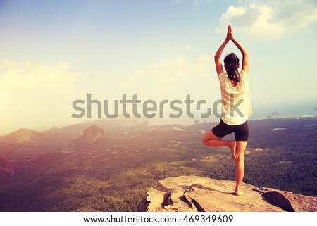 young fitness yoga woman at mountain peak #469349609