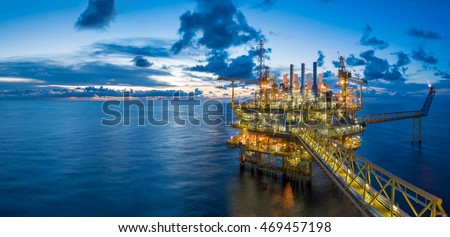 Panorama of Oil and Gas central processing platform in twilight, offshore hard work occupation twenty four working hours.  Royalty-Free Stock Photo #469457198