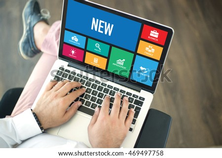 People using laptop in an office and NEW concept on screen #469497758