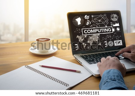 COMPUTING (data Computer Digital Memory) Computing Computer  flare sun, Cropped image male freelancer sitting at the table #469681181