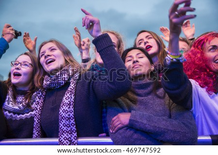 Traena, Norway - July 08, 2016: audience cheering at concert of Norwegian folk and rock band Violet Road at Traenafestival, music festival taking place on the small island of Traena in Norway #469747592