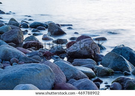 Rocky shore of the Baltic sea in the evening #469788902