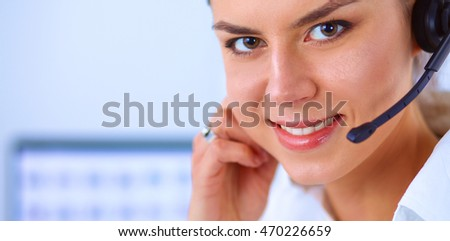 Close-up portrait of a customer service agent sitting at office #470226659