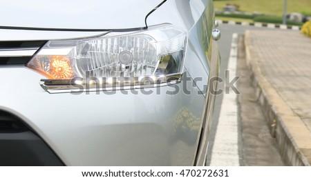 Daytime Running Light. Headlight LED daytime light for car. Lighting standards for cars and safety of motorists. #470272631
