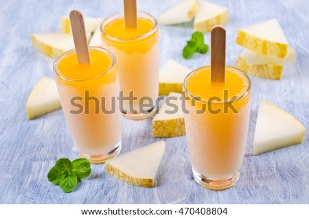 Homemade ice lolly of melon on a light background. Selective focus. #470408804