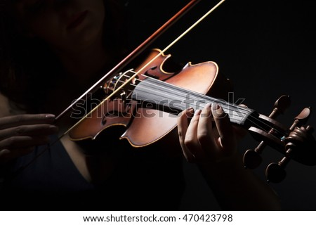 Violinist holding in your hands the violin.  Royalty-Free Stock Photo #470423798