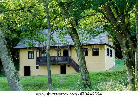 Old traditional house located in the picturesque landscape, Romania #470442554