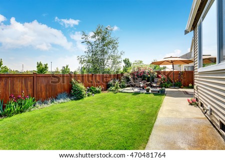 Beautiful landscape design for backyard garden and patio area on concrete floor. Northwest, USA #470481764