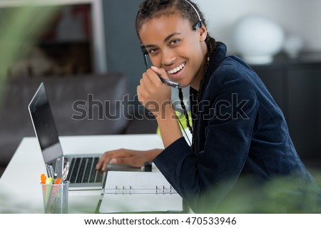 charming young woman in office #470533946