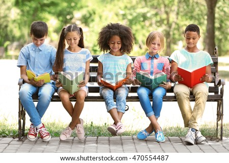 Cute kids reading books on bench #470554487
