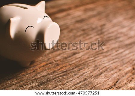 piggy bank on old wood Royalty-Free Stock Photo #470577251