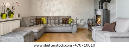 Beautiful living room with large sofa, fireplace, wood floor panels and decorative wall finish, panorama #470710010
