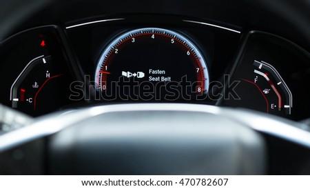 Fasten seat belt sign warning on car dashboard information for safety driver #470782607