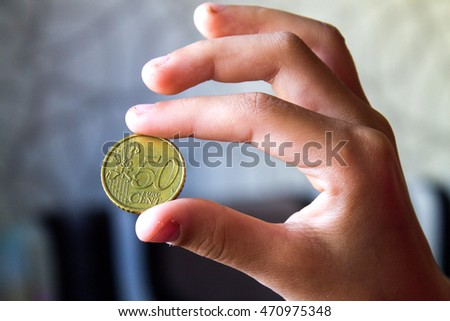 Coin in a hand, money of Europe, 50 cents #470975348