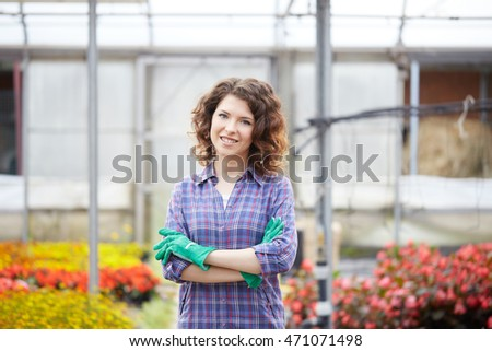 young lady working in a plant nursery #471071498