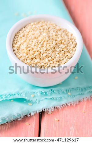 sesame seeds on wooden surface #471129617