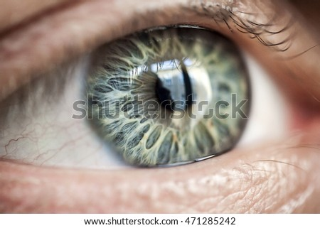 Very close macro photograph of a human eye with very special patterned iris and shallow depth of field